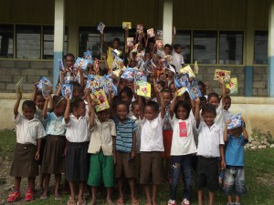 Students holding up their books.